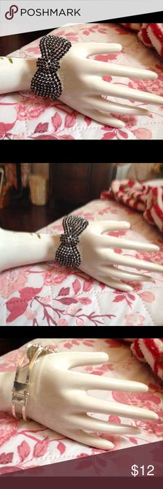 Beautiful crystal bracelet This bracelet is a wrap hinged  bracelet.  It is a stunning bow with no missing stones.  It has never been worn and would make a perfect gift. Jewelry Bracelets