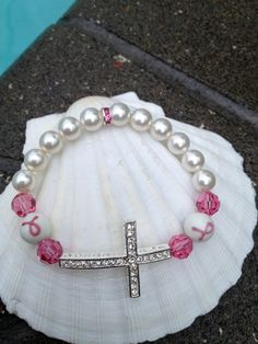 This makes for such a great party favor, gift or raffle item: Breast Cancer Awareness Silver Rhinestone Cross Crystal & Pearl Bracelet
