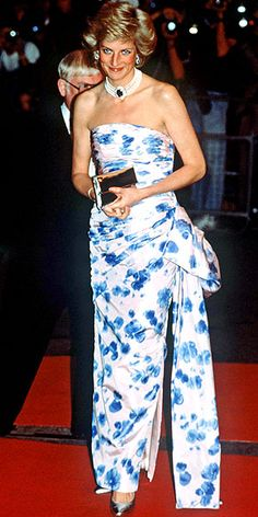 Wearing her signature pearl-and-sapphire choker, Diana showed off her toned arms and a floral gown with an oversized sash at a 1989 film premiere in London.