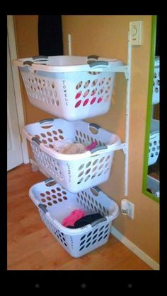 Laundry sorting bins. So in love with this idea!!
