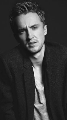 Tom Felton. He's British, an animal-lover, eloquent, plays the guitar, loves the beach,  and, damn, those eyes.
