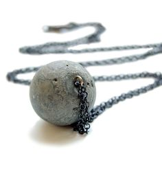 Globe Concrete Necklace | Women's Jewelry | Maple and Mauve | Scoutmob Shoppe | Product Detail Keep things ever-so-slightly edgy with this globe concrete necklace. The strong pendant is hand-cast over a gunmetal-plated brass pin, sanded, finished with sealant and then strung on a gunmetal-plated brass chain