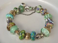Extraordinary green glass, Trollstones and gold beads on this Trollbeads bracelet by a member of Trollbeads Gallery Forum.