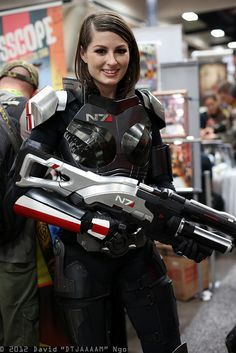 Awesome FemShep cosplay!! Why the N7 Valkyrie? I feel that the M-8 avenger is more Iconic. Oh god I am such a nerd being able to tell a Mass Effect gun from looking at it.