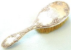 Antique Edwardian Collectible Sterling Silver Mounted Hair Brush, Dressing Table Item, Raised Floral Design, Distressed Look, Engraved Brush by AToasttothePast on Etsy https://www.etsy.com/listing/245774986/antique-edwardian-collectible-sterling