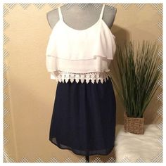 Navy/White Mini Dress Brand new never worn mini dress.  Top is ruffled with lace detail at bottom. It has adjustable straps.  All 100% Polyester.  Colors are Navy Blue and White. Teeze Me Dresses Mini