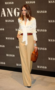 Olivia offers an elegant take on seasonal wear in Mango — just add a silky white blouse to wide-leg trousers.