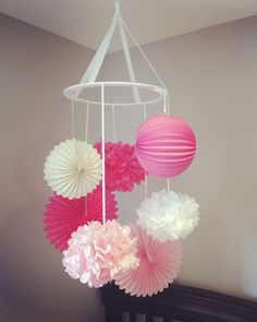DIY nursery mobile using tissue paper balls & lanterns. All supplies from…