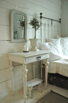 Beautiful simple white shabby chic bedroom in old house.: