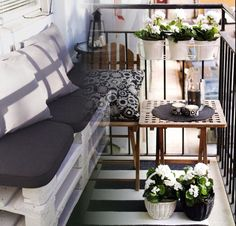 Monochrome decor and lightweight furniture make this small balcony comfortable and inviting without feeling like a tight squeeze.