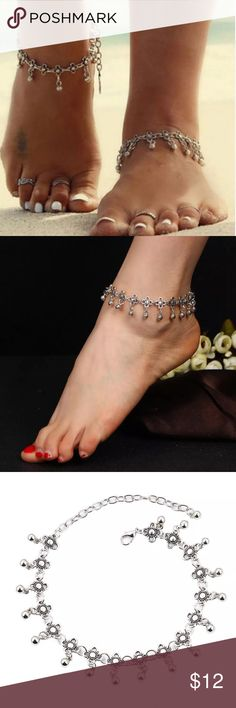 🎉5/$25🎉 Boho Silver Flower Anklet Bohemian Flower with Dangle Silver Tone Anklet (comes with one anklet) All jewelry comes in organza gift bag.   See my other listings with 5 for $25 SALE and save on a bundle! Lots of clothes, bags, jewelry and new boutique items. Great for gift giving. I love accepting offers. Boutique Jewelry