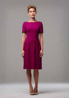 MAGENTA WOOL CREPE DRESS A dropped waist wool crepe dress with a short sleeve and gathered waist. Also available in a selection of other colours.