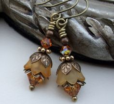 Adorable Antique Brass, Swarovski Crystal, Lucite Flower Earrings. $14.50, via Etsy.
