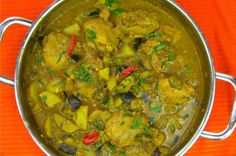 Curry chicken with potatoes and eggplant done in a traditional Caribbean way.