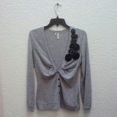 Studio Y Gray Sweater with Black Rosettes Studio Y brand from Maurices, size small, in excellent condition! Gray cardigan sweater features black buttons and black tulle rosettes with silver beads. A simple and classy sweater! Please ask any and all questions before purchasing. Thanks! Maurices Sweaters Cardigans