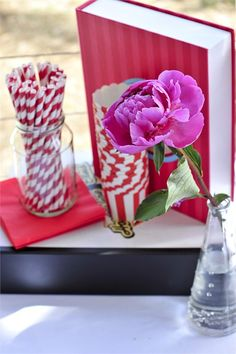 Quirky and colourful wedding decor from Dusty Miller Designs including pink peonies and candy striped straws.