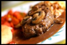 It's what's for dinner tonight!   Salisbury Steak with Mushroom Gravy, Cheesy Baked Mashed Red Potatoes, Candied Carrots, and Garlic Rolls. I am STUFFED! Eat your heart out vegetarians! ;)