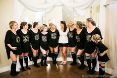 Bridesmaids getting ready attire matching monogrammed shirts with big comfy socks