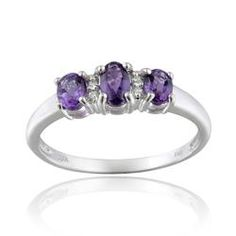@Overstock - Diamond and amethyst three-stone ringSterling silver jewelryClick here for ring sizing guidehttp://www.overstock.com/Jewelry-Watches/Glitzy-Rocks-10k-White-Gold-Diamond-And-Amethyst-Three-stone-Ring/6771462/product.html?CID=214117 $127.79