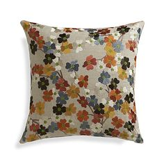 A profusion of pansy-like flowers bloom springtime color on natural linen. This beautiful pillow gets a slight sheen from rayon embroidery, reversing to plush cotton velvet in solid orange.