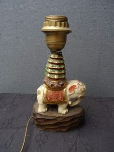 A fabulous antique Satsuma elephant lamp. The lamp has a moriage elephant on the base. the elephant is set on a chip carved wood base. It has its original shade. Stands 23cm high without shade and 23cm high with shade. | eBay!