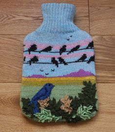 Knitted hot water bottle cover with birds on a wire design £35.00