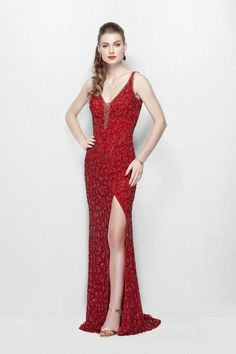 Primavera Exchange glances in this mesmerising evening gown that sparkles througout in a unique fashion. The plunging neckline is accentuated with a delicate beading and a sheer modesty panel. The high slit and a demure back makes it look sophisticated at the best. Available in Red & White.