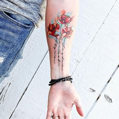 Poppy tattoo with my kids names in the stems.