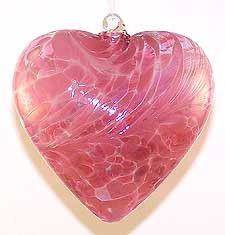 """Looking for a Valentine's Day gift? Look no further as this is a great gift for the one you love. This large rose colored heart is opaque pink with wine red, molded into a heart shape. 5"""" across appro"""