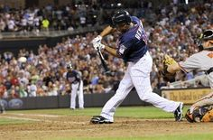 Minnesota Twins' Ben Revere hits an RBI single off Baltimore Orioles pitcher Pedro Strop in the seventh inning of a baseball game, Tuesday, July 17, 2012, in Minneapolis. Catching is Orioles' Matt Wieters.