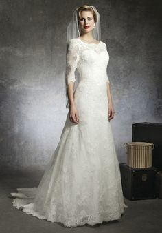 Sabrina Alencon lace neckline with 3 quarter length sleeves that accent the drop waist and A-line skirt. Gown has a V-back, buttons that cover the back zipper and the sweep length train.