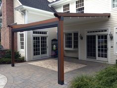 The Gennius Pergola Awning with cover projected, and solar shade retracted