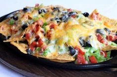 What happens when you mix Mexican and Italian food? You get Cast Iron Skillet Pizza Nachos. The perfect meal or appetizer to feed your crowd anytime of the year from football games to family dinners. Click here for full recipe from Tasty Kitchen
