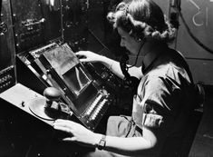 WAAF radar operator Denise Miley plotting aircraft on the CRT (cathode ray tube) of an RF7 Receiver in the Receiver Room at Bawdsey Chain Home Station, WWII (Imperial War Museum)