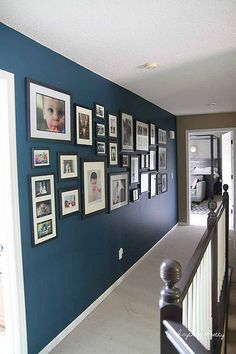 A Navy Gallery Wal. This would be a great solution for the stepped niche above our stairs.