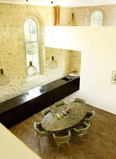 Florence Knoll marble table and Saarinen chairs in a remodeled chapel turned home.