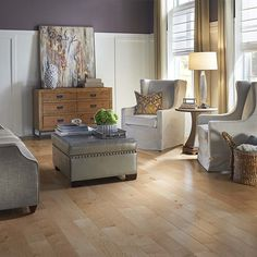 Try lightening up a purple room with neutral furniture and decor with PERGO Max Natural Maple hardwood floor.