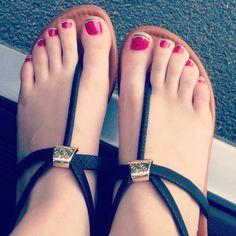 Pedicure at the nail salon, super easy! 1) polish toes pink polish 2) apply thin green line polish 3)apply thin white line polish 4) apply black polish seeds 5)clear polish