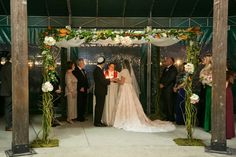 Natural chuppah idea - chuppah draped in greenery, branches and fresh flowers  {Bradley Images, inc.}