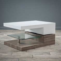 Modern and elegant, this Novia coffee table features contrasting finishes of white and walnut to create a one of a kind experience. A side storage compartment adds functionality to this beautiful coff