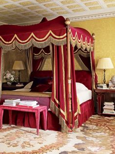 Red Canopy Bed - Very regal with the bullion fringe and tape accents. Don'