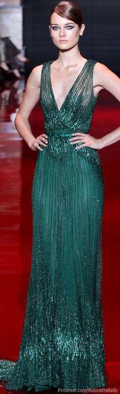 This dress is incredible. Elie Saab Haute Couture | #beaded #gown #dress | This green evening gown can be made for you by www.DariusCordell.com