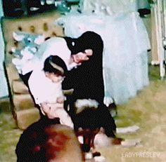 Priscilla and Lisa Marie Presley in the nursery at Graceland with Baba, c. 1969.