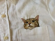 Fashion and the Internet have collided spectacularly in this series of awesome embroidered cat shirts by Japanese embroidery artist Hiroko Kubota. Japanese Embroidery, Embroidery Art, Cross Stitch Embroidery, Embroidery Patterns, Machine Embroidery, Funny Embroidery, Embroidery Jewelry, Textiles, Pocket Cat