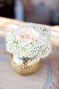 Not a fan of baby's breath but with a punch of small roses, peonies or hydrangeas it'd be perfect!!