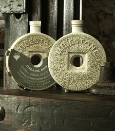 Original Bottle Design and Packaging for Milestone. The bottle is made of stoneware and represents a traditional millstone