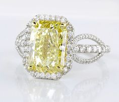 Engagement ring. Featuring a natural Fancy Canary Yellow radiant diamond  weighing nearly 3 carats,