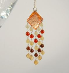 Fringed copper pendant with silver chain (orange, red, yellow) £40.00