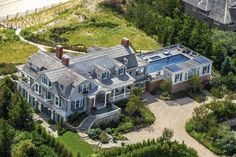 The house and adjoining pool sit between a pea gravel motor court and the rear lawn. The master suite and children's bedrooms fill the dutch gambrel roof and dormers; the roofscape suggests the complexity of fitting in all the second-floor rooms.