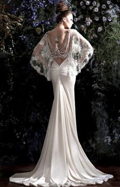 .love the ruched butt and low back... not a fan of the sleeves and pearls